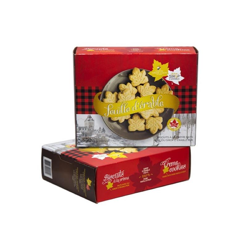 Schachtel mit cremefarbenen Ahornblattplätzchen